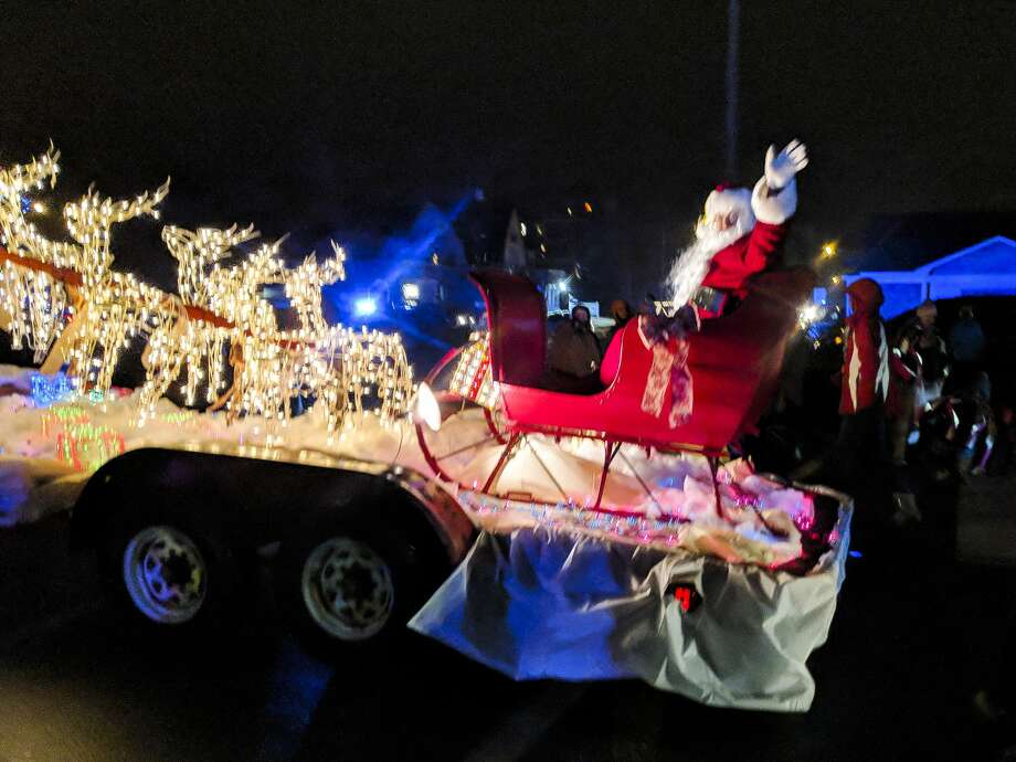 An estimated 120 floats, balloons, trucks, tractors, public safety vehicles and others traveled the route Saturday, Dec. 1, 2018  for the 16th annual Gladwin County Festival of Lights Parade. About 7,000 people watched the event despite the rainy, windy and bitter cold night. (Tereasa Nims/for the Daily News) Photo: (Tereasa Nims/for The Daily News)