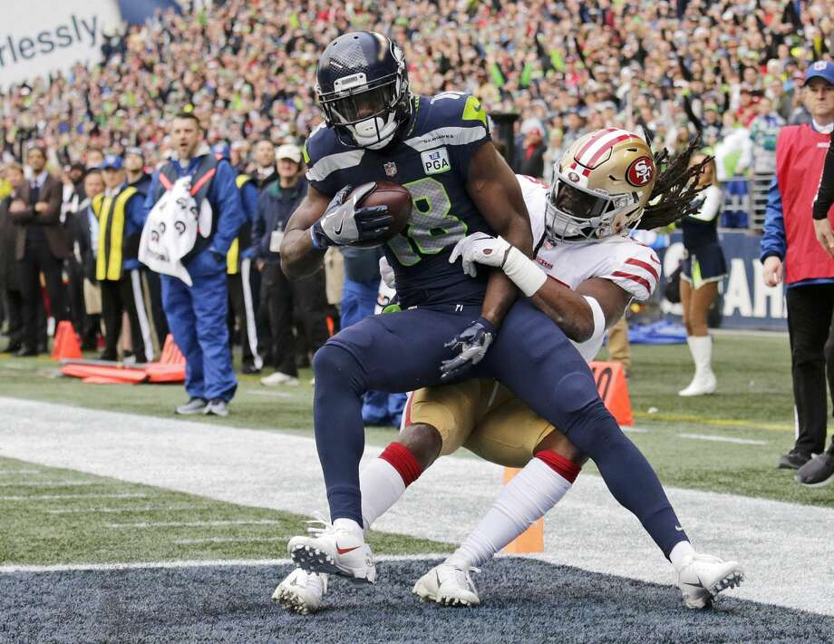 Seattle Seahawks wide receiver Jaron Brown is tackled by San Francisco 49ers defensive back Marcell Harris, right, as he scores a touchdown during the first half of an NFL football game, Sunday, Dec. 2, 2018, in Seattle. (AP Photo/John Froschauer) Photo: John Froschauer/AP