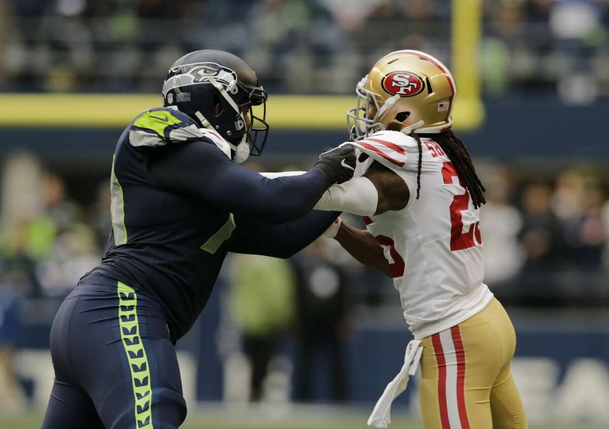 San Francisco 49ers cornerback Richard Sherman, right, blocks Seattle Seahawks offensive tackle George Fant, left, during the first half of an NFL football game, Sunday, Dec. 2, 2018, in Seattle. (AP Photo/John Froschauer)