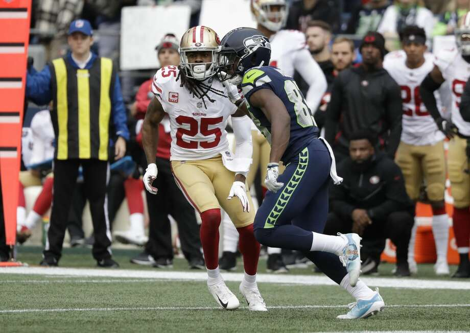 San Francisco 49ers cornerback Richard Sherman, left, lines up against Seattle Seahawks wide receiver David Moore, right, during the first half of an NFL football game, Sunday, Dec. 2, 2018, in Seattle. (AP Photo/Elaine Thompson) Photo: Elaine Thompson/AP
