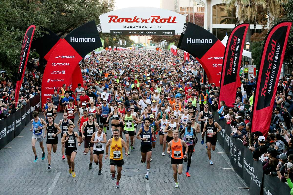 Runners take off from the starting line of the Humana Rock 'n' Roll Marathon on W. Market St. on Sunday, Dec. 2, 2018.