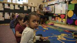 A child at one of Family Service Association's head start facilities in San Antonio looks at the back of a classroom during Tennell Harris's class on Thursday, November 1st, 2018.
