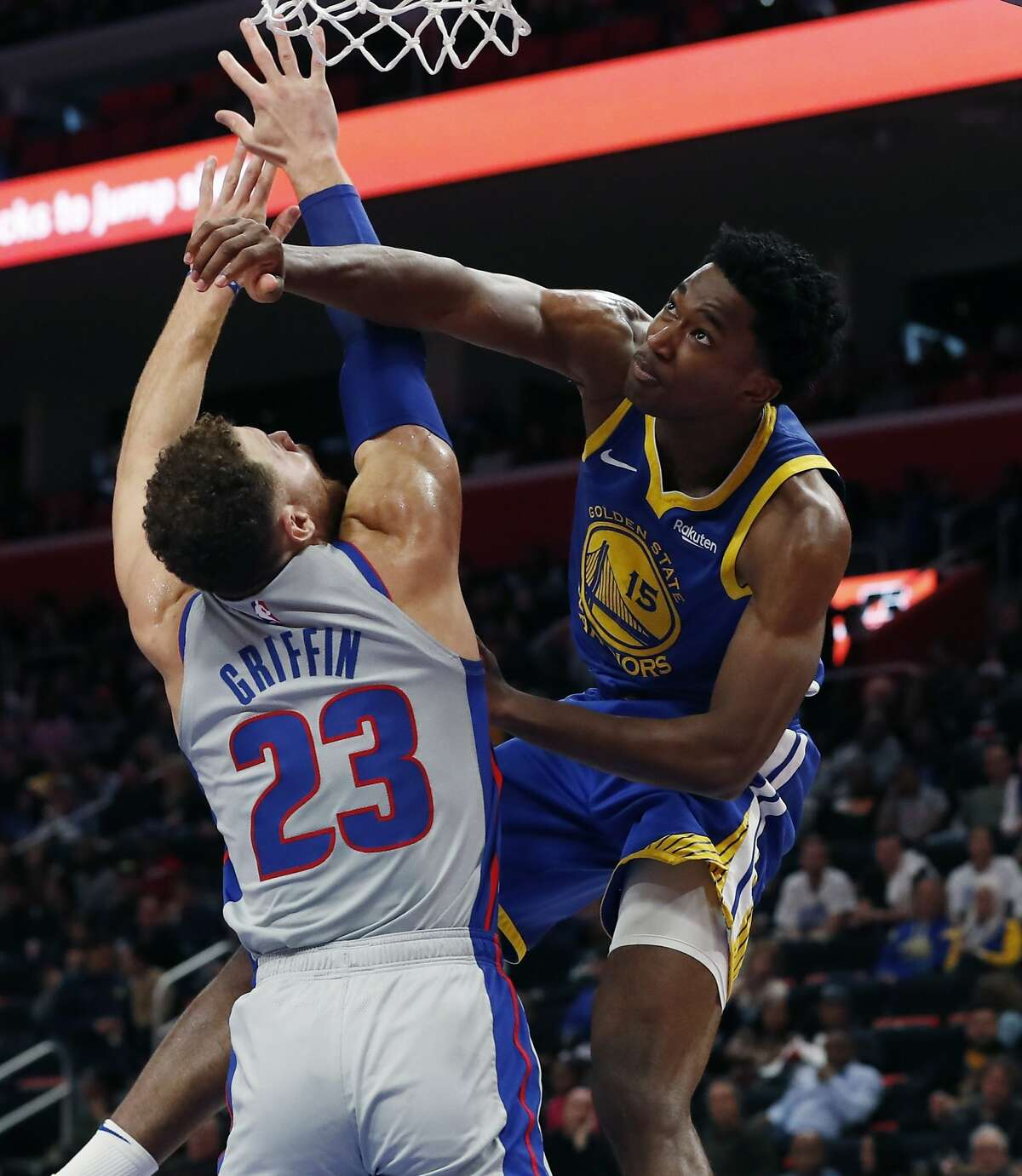 Golden State Warriors center Damian Jones (15) and Detroit Pistons forward Blake Griffin (23) fight for the rebound during the second half of an NBA basketball game, Saturday, Dec. 1, 2018, in Detroit. (AP Photo/Carlos Osorio)