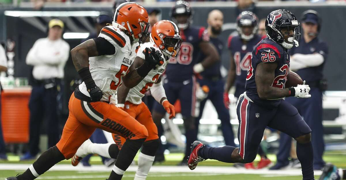 Houston Texans running back Lamar Miller (26) runs for a first down against the Cleveland Browns during the fourth quarter of an NFL football game at NRG Stadium on Sunday, Dec. 2, 2018, in Houston.
