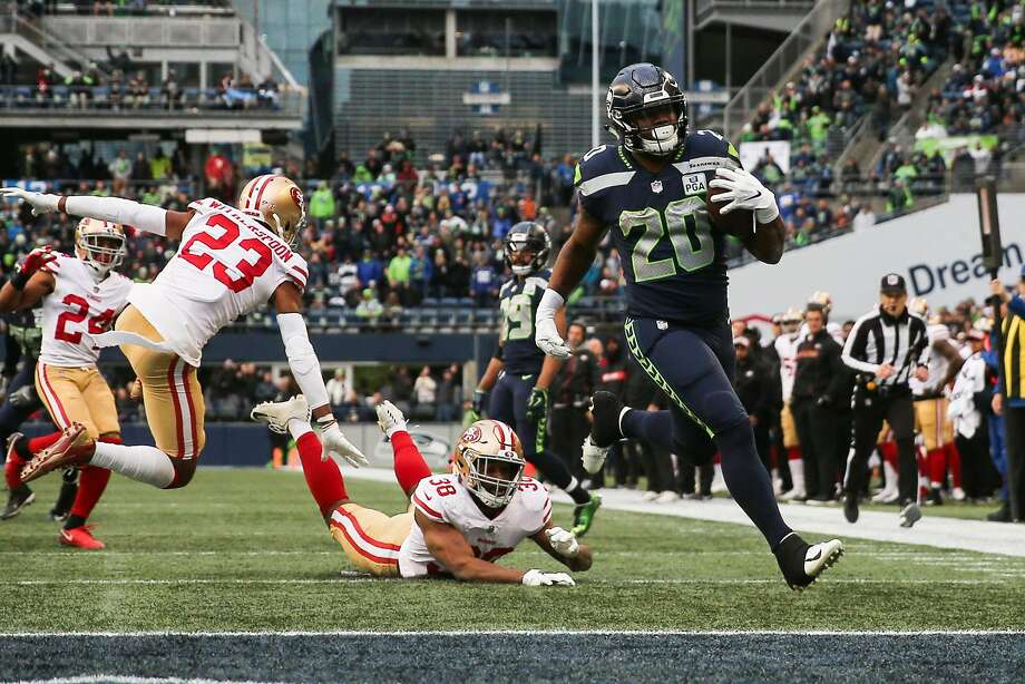 Rashaad Penny (20) of the Seahawks avoids a tackle by the 49ers' Antone Exum for a 20-yard touchdown in the third quarter. Photo: Abbie Parr / Getty Images