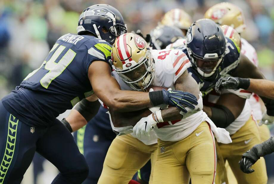 San Francisco 49ers running back Jeff Wilson is tackled by Seattle Seahawks middle linebacker Bobby Wagner, left, as he rushes during the first half of an NFL football game, Sunday, Dec. 2, 2018, in Seattle. (AP Photo/John Froschauer) Photo: John Froschauer / Associated Press