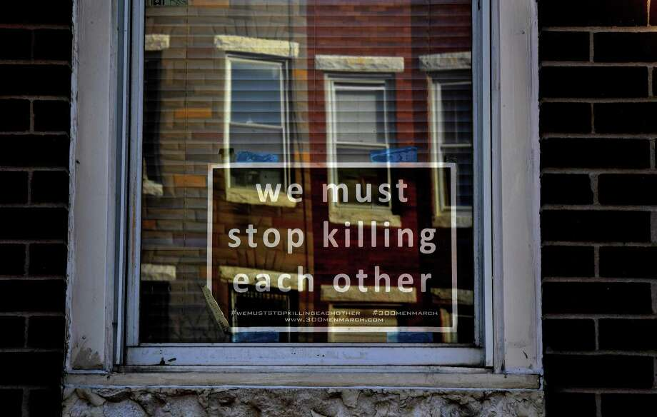 A plea for an end to violence is displayed in the window of a Baltimore home, just yards from where 5-year-old Amy Hayes was shot Nov. 19. Photo: Washington Post Photo By Michael S. Williamson / The Washington Post