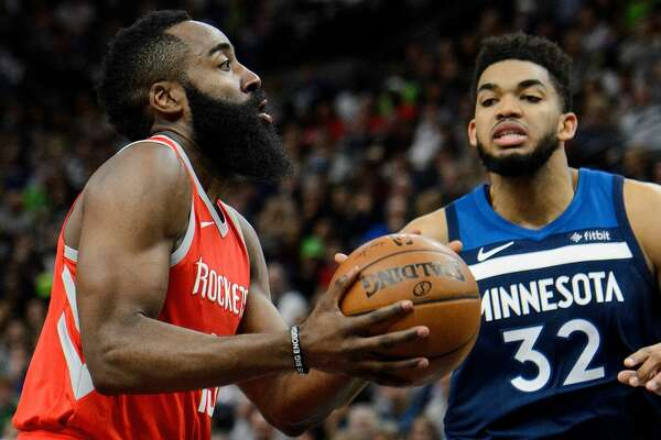 MINNEAPOLIS, MN - APRIL 21: James Harden #13 of the Houston Rockets shoots the ball against Karl-Anthony Towns #32 of the Minnesota Timberwolves in Game Three of Round One of the 2018 NBA Playoffs on April 21, 2018 at the Target Center in Minneapolis, Minnesota. The Timberwolves defeated 121-105. NOTE TO USER: User expressly acknowledges and agrees that, by downloading and or using this Photograph, user is consenting to the terms and conditions of the Getty Images License Agreement. (Photo by Hannah Foslien/Getty Images)