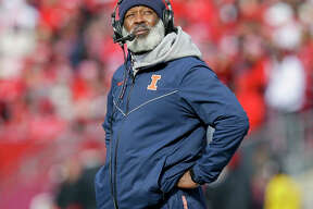 Illinois coach Lovie Smith looks at the scoreboard after a Wisconsin touchdown during the Illini's 49-20 loss Oct. 20 in Madison, Wis.