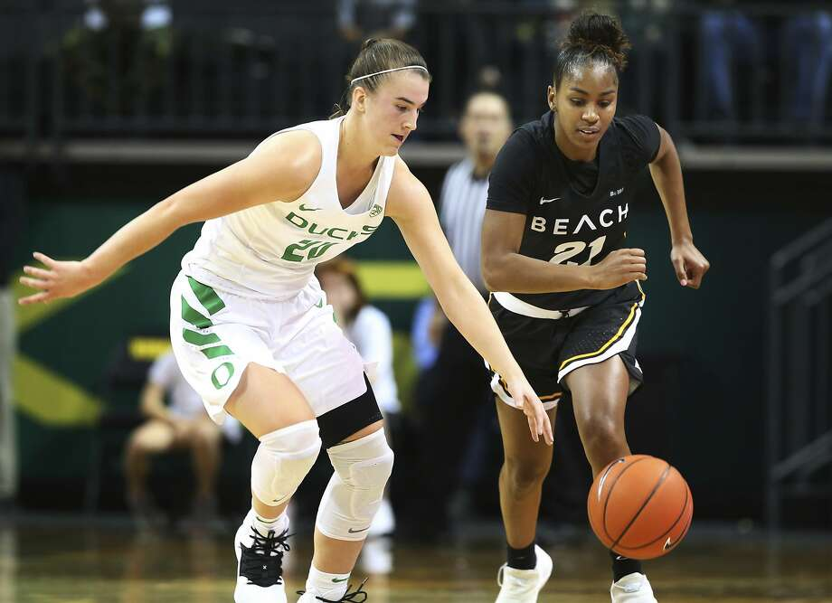 Oregon's Sabrina Ionescu (left) forces a turnover against Long Beach State's Shanaijah Davison on Sunday in Eugene. Ionescu had a school record 17 assists in the game. Photo: Chris Pietsch / The Register-Guard