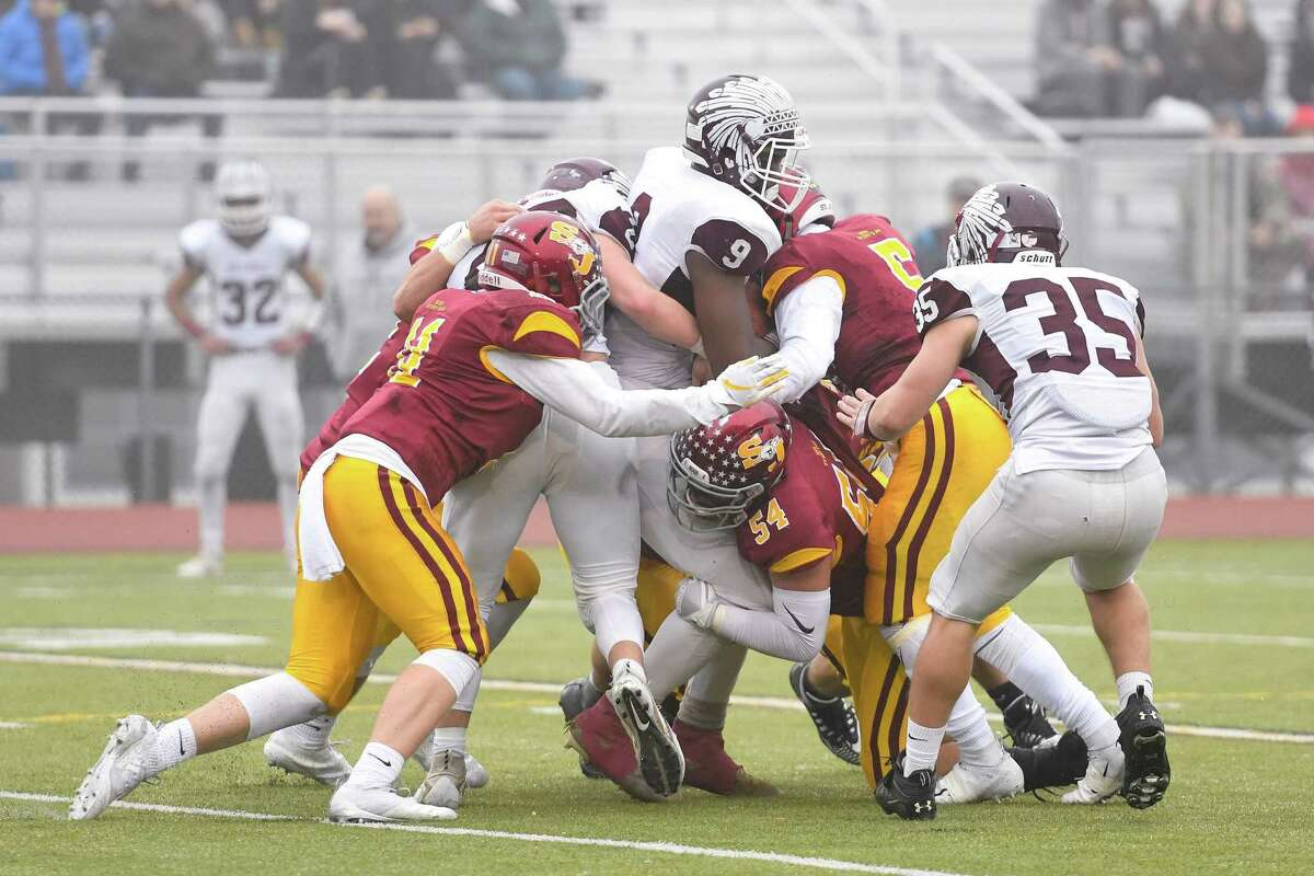 Killingly's Nsaiah Harriet is tackled by St. Joseph during the Class M semifinals on Sunday, Dec. 2, 2018 at Trumbull High School in Trumbull, Conn. St. Joseph won 52-7.