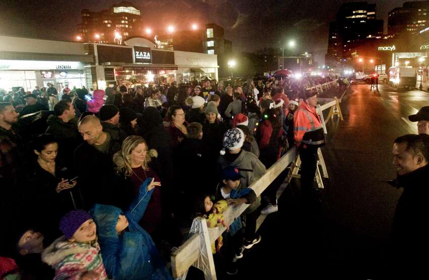 A large crowd gathers to watch Santa Claus rappel the side of the building at One Landmark Square. Sunday, Dec. 2, 2018