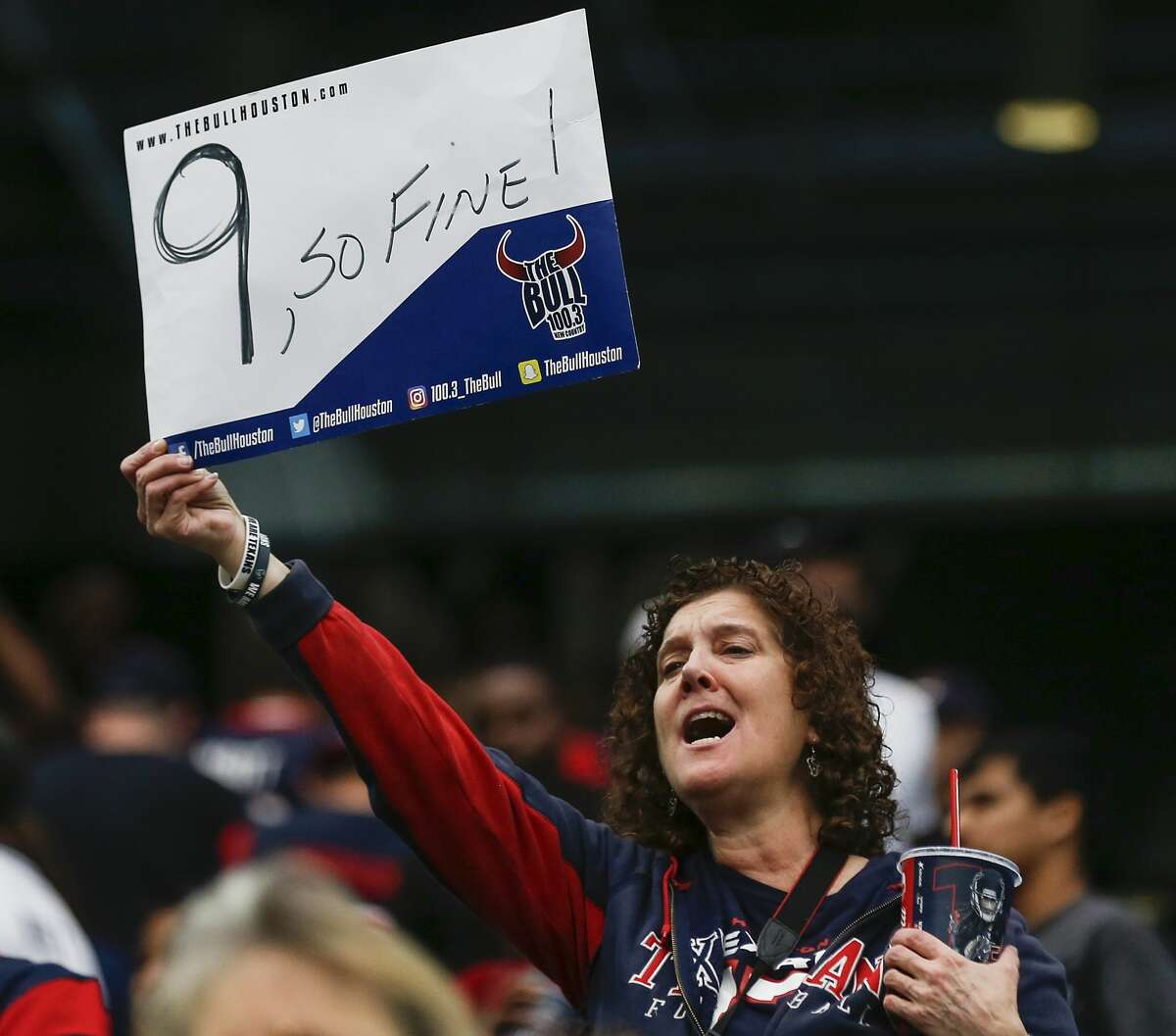 A Houston Texans fan holds up a sign signifying the Texans ninth consecutive win, a 29-13 win over the Cleveland Browns at NRG Stadium on Sunday, Dec. 2, 2018, in Houston.