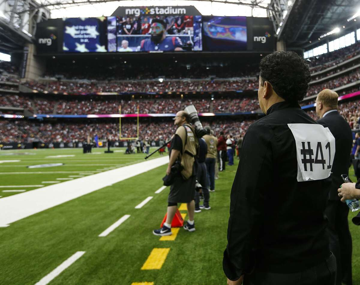 Chef Hugo Ortega wears a #41 on his back to honor former President George H.W. Bush before the Houston Texans NFL football game against the Cleveland Browns at NRG Stadium on Sunday, Dec. 2, 2018, in Houston.