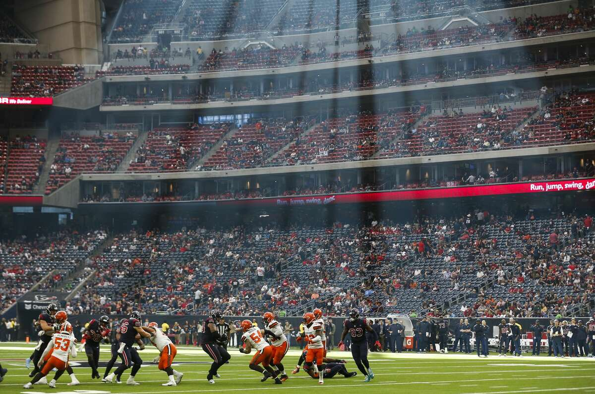 The Houston Texans run a play under a stream of sunlight against the Cleveland Browns during the fourth quarter of an NFL football game at NRG Stadium on Sunday, Dec. 2, 2018, in Houston.