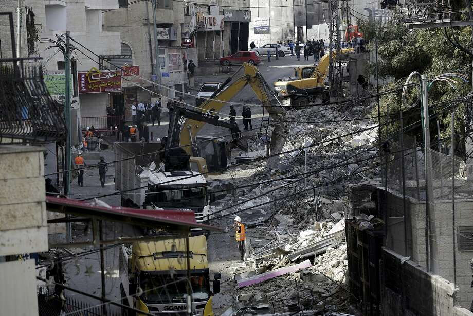 Israeli authorities demolish shops Nov. 21 in east Jerusalem. The contested sector is the focus of an increasingly visible battle between Palestinians and Israel for control. Photo: Mahmoud Illean / Associated Press