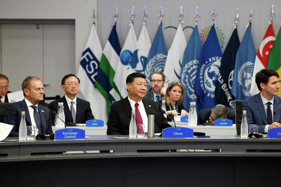 China's President Xi Jinping, center, attends a meeting at the G-20 Leaders' Summit in Buenos Aires, Argentina, on Friday. Photo: Bloomberg Photo By Erica Canepa / Bloomberg