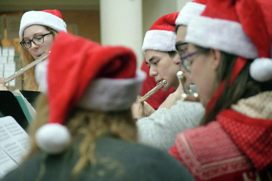 Members of the RPI Flute Ensemble perform at the Troy Atrium during the 36th Annual Troy Victorian Stroll on Sunday, Dec. 2, 2018, in Troy, N.Y.    (Paul Buckowski/Times Union) Photo: Paul Buckowski / (Paul Buckowski/Times Union)