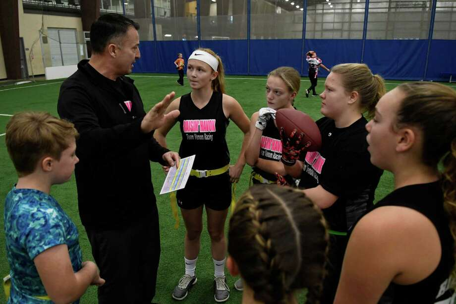 Mike Barker, organisation head for girls' flag football, instructs his players in offensive play at Half-moon Sportsplex on Sunday, Dec. 2, 2018, in Hlafmoon, N.Y. (Jenn March, Special to the Times Union ) Photo: Jenn March / © Jenn March 2018 © Albany Times Union 2018