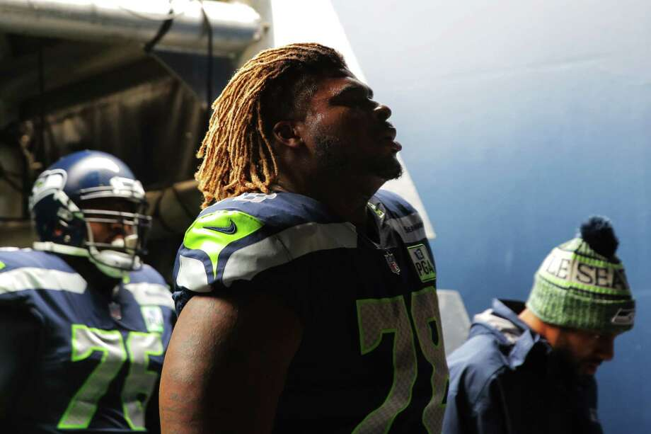 Seahawks offensive lineman D.J. Fluker walks into the locker room before Seattle's game against San Francisco, Sunday, Dec. 2, 2018 at CenturyLink Field. Photo: GENNA MARTIN, SEATTLEPI.COM / SEATTLEPI.COM