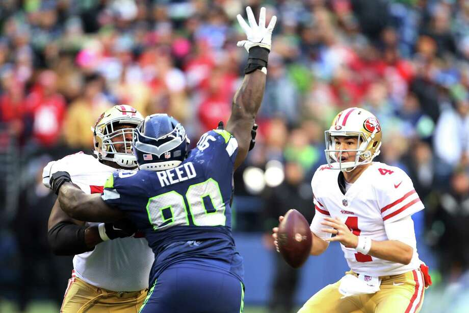Seahawks defensive lineman Jarran Reed puts a hand up to block a pass from 49ers quarterback Nick Mullens during the third quarter of Seattle's game against San Francisco, Sunday, Dec. 2, 2018 at CenturyLink Field. Photo: GENNA MARTIN, SEATTLEPI.COM / SEATTLEPI.COM