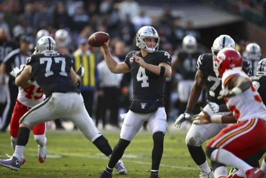 337747e2842 Oakland Raiders quarterback Derek Carr (4) passes against the Kansas City  Chiefs during the