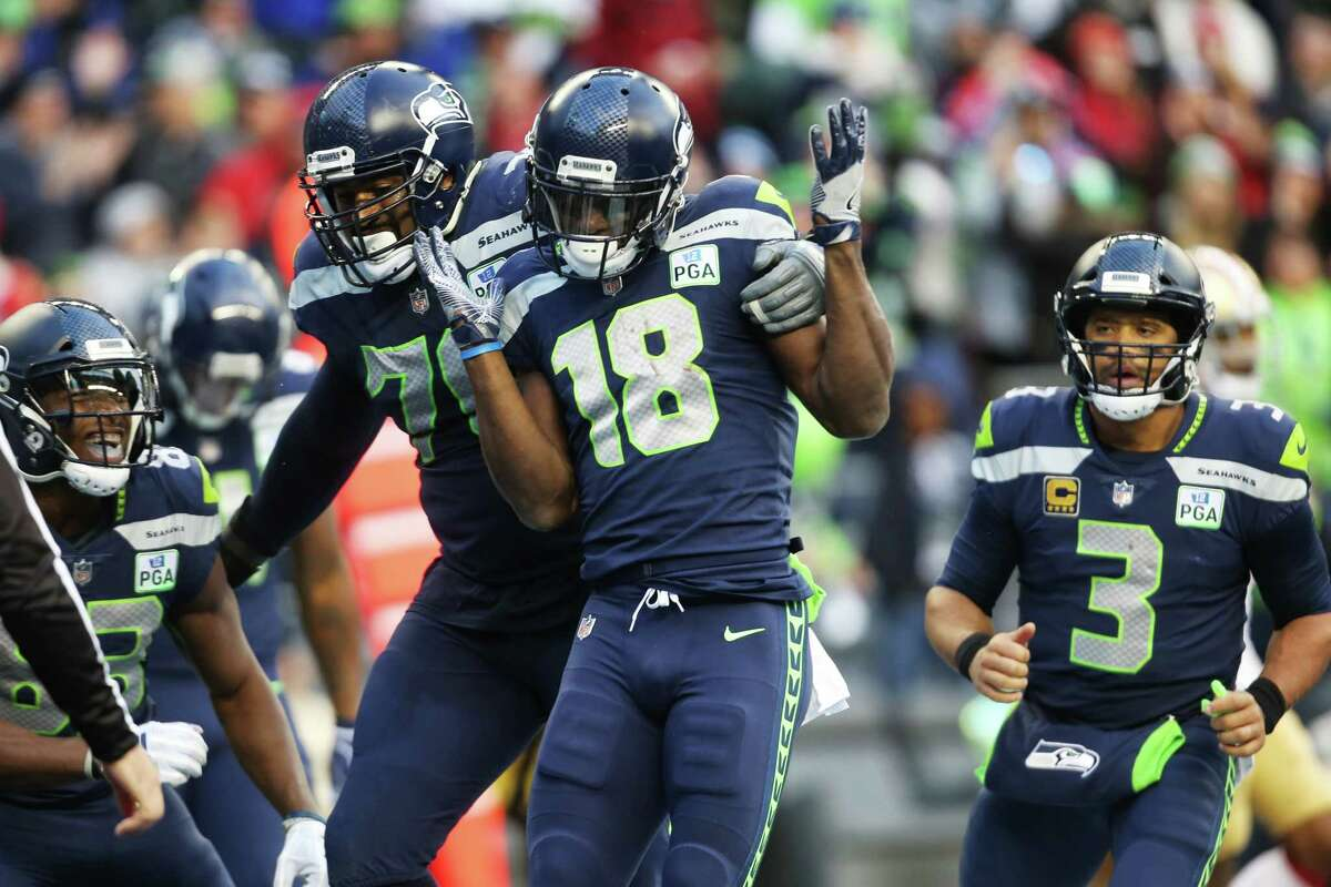 The Seahawks offense celebrates a touchdown by wide receiver Jaron Brown (18) during the third quarter of Seattle's game against San Francisco, Sunday, Dec. 2, 2018 at CenturyLink Field.