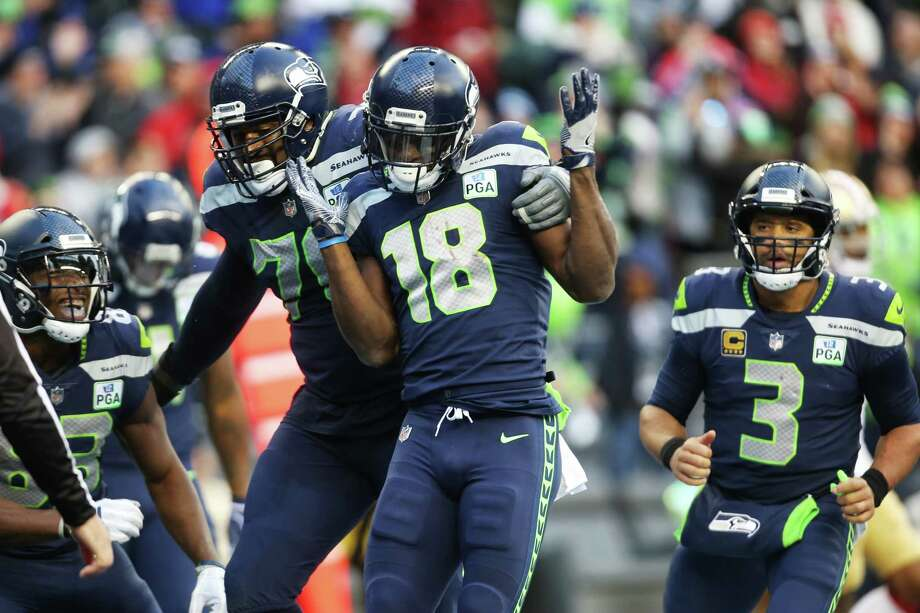 The Seahawks offense celebrates a touchdown by wide receiver Jaron Brown (18) during the third quarter of Seattle's game against San Francisco, Sunday, Dec. 2, 2018 at CenturyLink Field. Photo: GENNA MARTIN, SEATTLEPI.COM / SEATTLEPI.COM