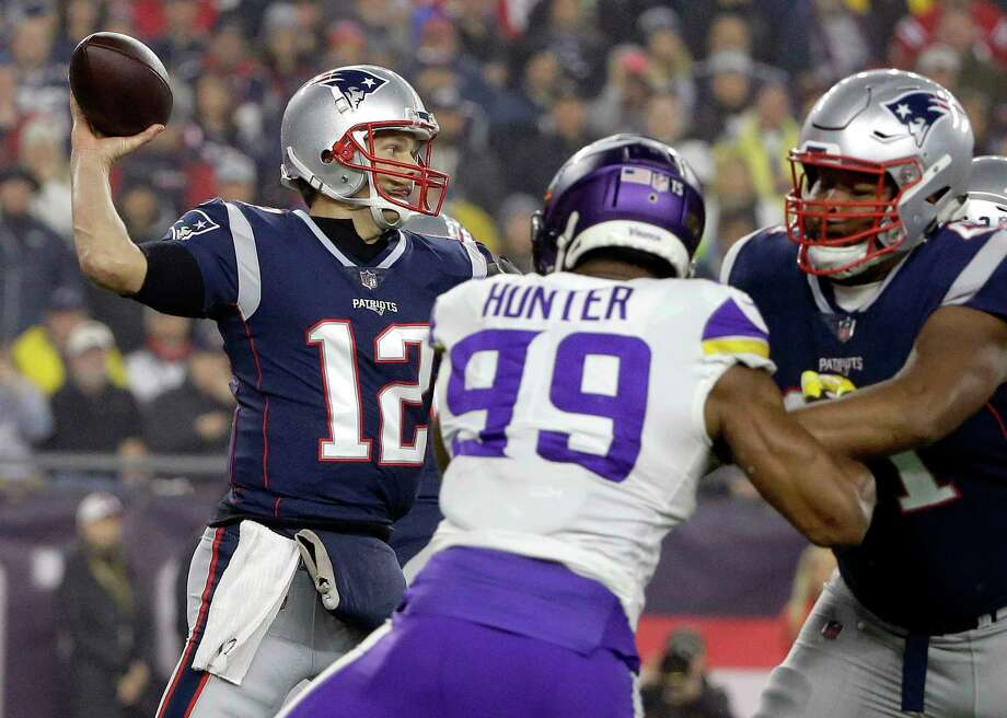 New England Patriots quarterback Tom Brady (12) passes under pressure from Minnesota Vikings defensive end Danielle Hunter (99) during the first half of an NFL football game, Sunday, Dec. 2, 2018, in Foxborough, Mass. (AP Photo/Steven Senne) Photo: Steven Senne / Copyright 2018 The Associated Press. All rights reserved