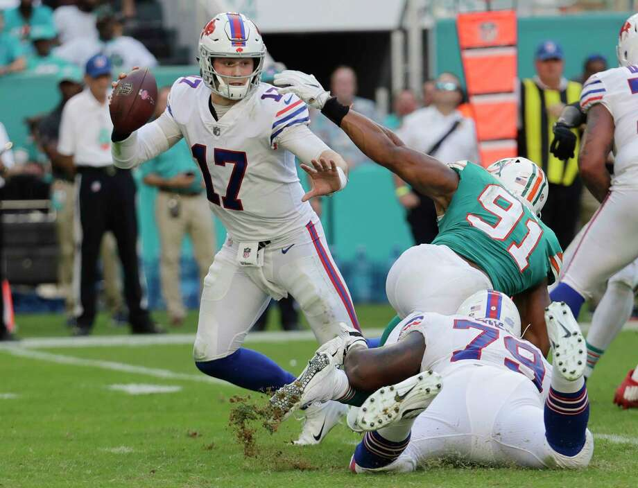 Buffalo Bills quarterback Josh Allen (17) avoids a tackle by Miami Dolphins defensive end Cameron Wake (91), during the second half of an NFL football game, Sunday, Dec. 2, 2018, in Miami Gardens, Fla. (AP Photo/Lynne Sladky) Photo: Lynne Sladky / Copyright 2018 The Associated Press. All rights reserved.