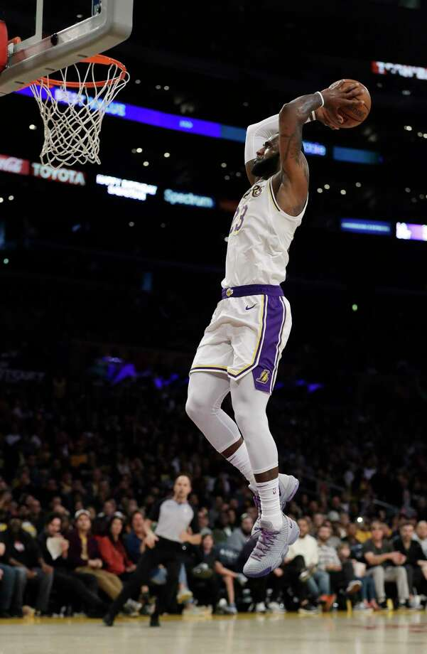 Los Angeles Lakers' LeBron James scores on a breakaway dunk against the Phoenix Suns during the second half of an NBA basketball game Sunday, Dec. 2, 2018, in Los Angeles. (AP Photo/Marcio Jose Sanchez) Photo: Marcio Jose Sanchez / Copyright 2018 The Associated Press. All rights reserved.