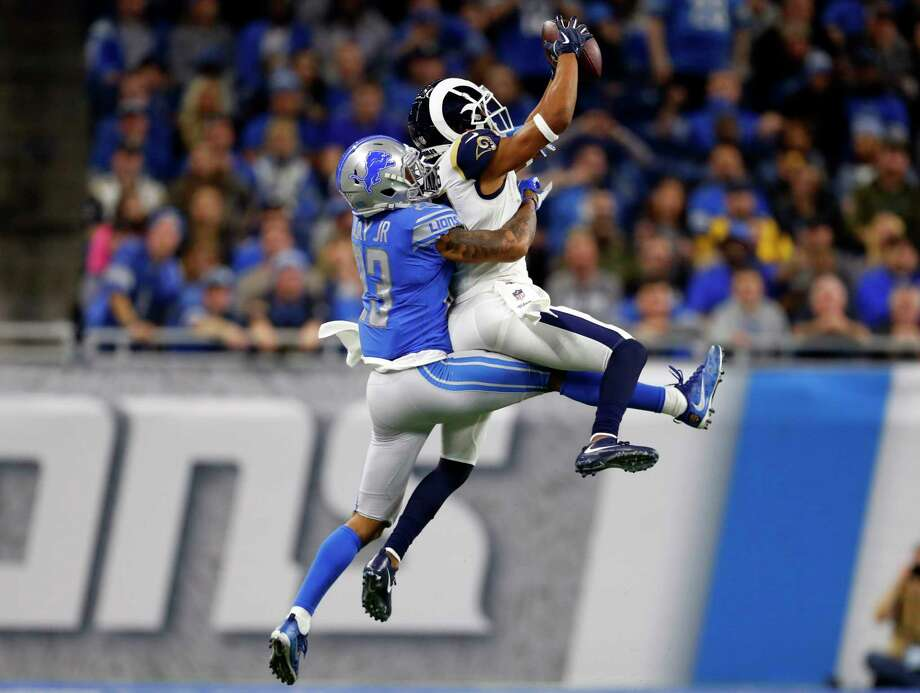 Los Angeles Rams wide receiver Robert Woods, defended by Detroit Lions cornerback Darius Slay (23), makes a catch during the first half of an NFL football game, Sunday, Dec. 2, 2018, in Detroit. (AP Photo/Paul Sancya) Photo: Paul Sancya / Copyright 2018 The Associated Press. All rights reserved.