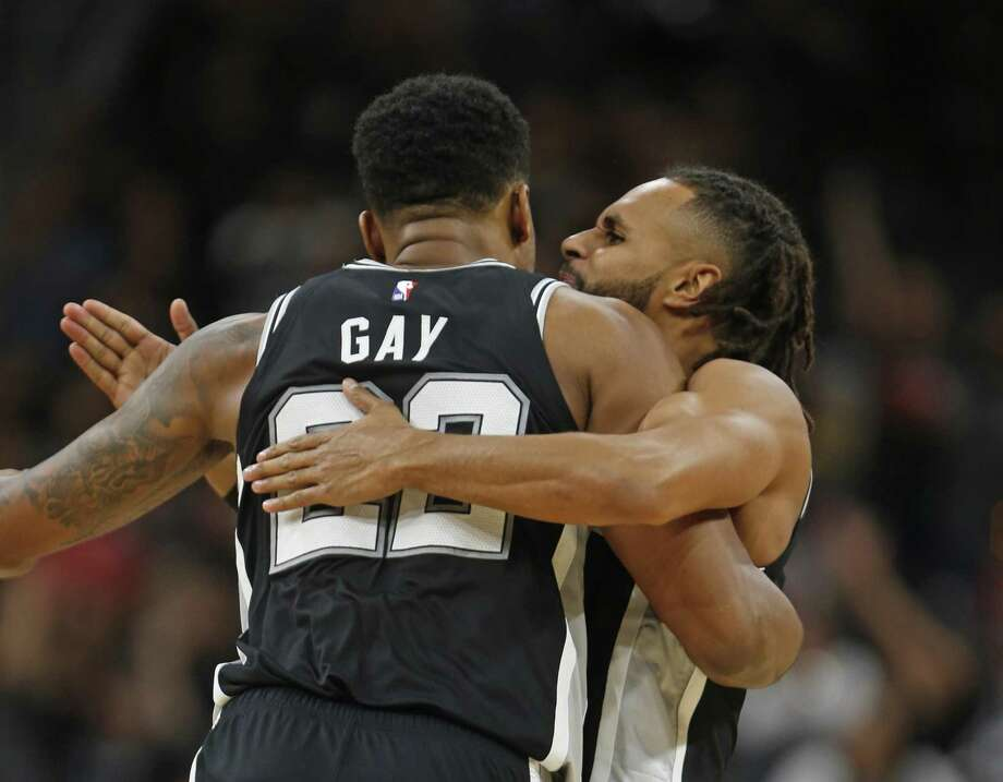 Not all hugs are as harmless as this one — Rudy Gay of the Portland Trail Blazers hugs Patty Mills of the Spurs recently. Women have legitimately become leery of unsolicited hugs. Photo: Ronald Cortes /Contributor / / 2018 Ronald Cortes