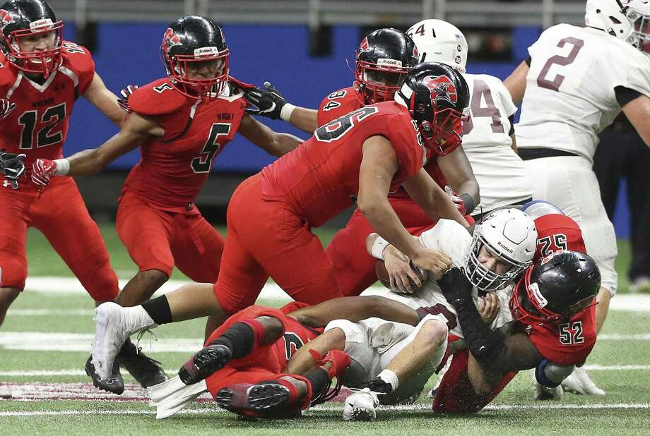 Hornet quarterback Braden Sherron is smacked down in the backfield by Dejoun Price of the Thunderbird defense as Wagner takes on Flour Bluff in third round high school football playoff action at the Alamodome on November 30, 2018. Photo: Tom Reel, Staff / Staff Photographer / 2017 SAN ANTONIO EXPRESS-NEWS