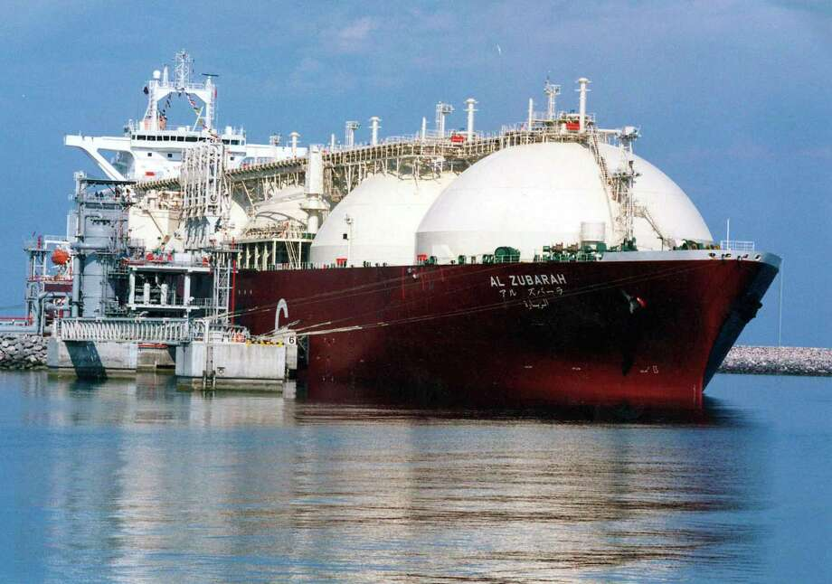 FILE - This undated file photo shows a Qatari liquid natural gas (LNG) tanker ship being loaded up with LNG at Raslaffans Sea Port, northern Qatar. Photo: Anonymous, AP / AP2005
