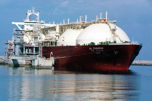 FILE - This undated file photo shows a Qatari liquid natural gas (LNG) tanker ship being loaded up with LNG at Raslaffans Sea Port, northern Qatar. The tiny, energy-rich Arab nation of Qatar announced on Monday, Dec. 3, 2018 it would withdraw from OPEC, mixing its aspirations to increase production outside of the cartel's constraints with the politics of slighting the Saudi-dominated group amid the kingdom's boycott of Doha.