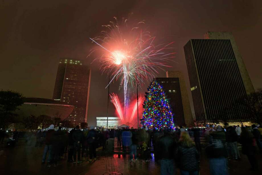 Fireworks explode above the Empire State Plaza during the lighting of the official New York State Holiday Tree on Sunday, Dec. 2, 2018, in Albany, N.Y.   (Paul Buckowski/Times Union) Photo: Paul Buckowski / (Paul Buckowski/Times Union)