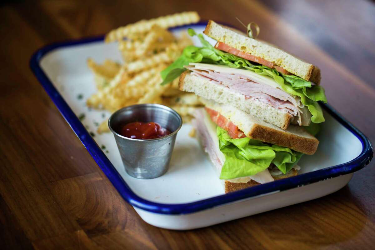 Betsy's Turkey's and Swiss sandwich with thin turkey, lettuce, tomato and mayo.