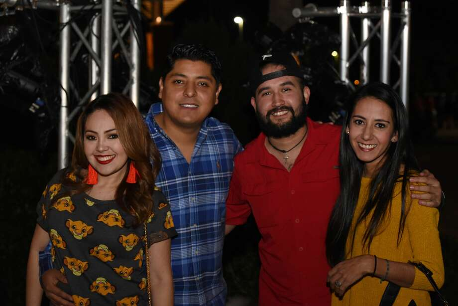 Attendees pose for a photo during the Caifanes concert. Photo: Christian Alejandro Ocampo