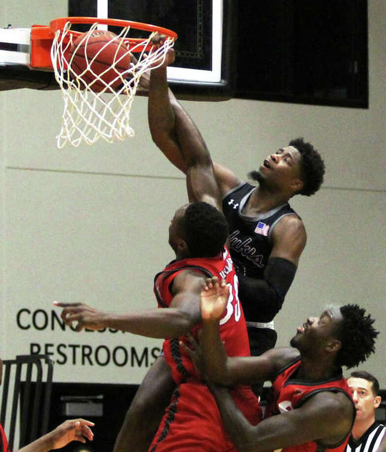 SIUC's Armon Fletcher, a senior from Edwardsville, throws down a dunk over SIUE defenders during Saturday's men's college basketball game at Vadalabene Center in Edwardsville. Fletcher, a former all-stater with the Edwardsville Tigers, scored 24 points against the Cougars to surpass 1,000 points for his career with the Salukis. Photo: Greg Shashack / The Telegraph