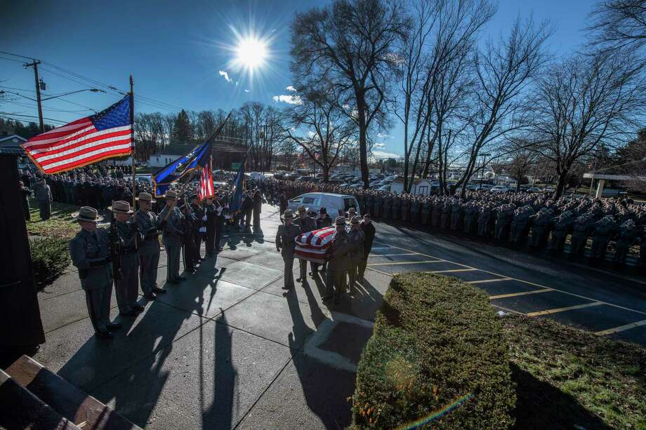 The casket is carried in to St. Gabriel The Archangel Roman Catholic Church for the funeral of fallen Trooper Jeremy VanNostrand Monday Dec. 3, 2018 in Schenectady, N.Y.  (Skip Dickstein/Times Union) Photo: SKIP DICKSTEIN, Albany Times Union / 20045606A