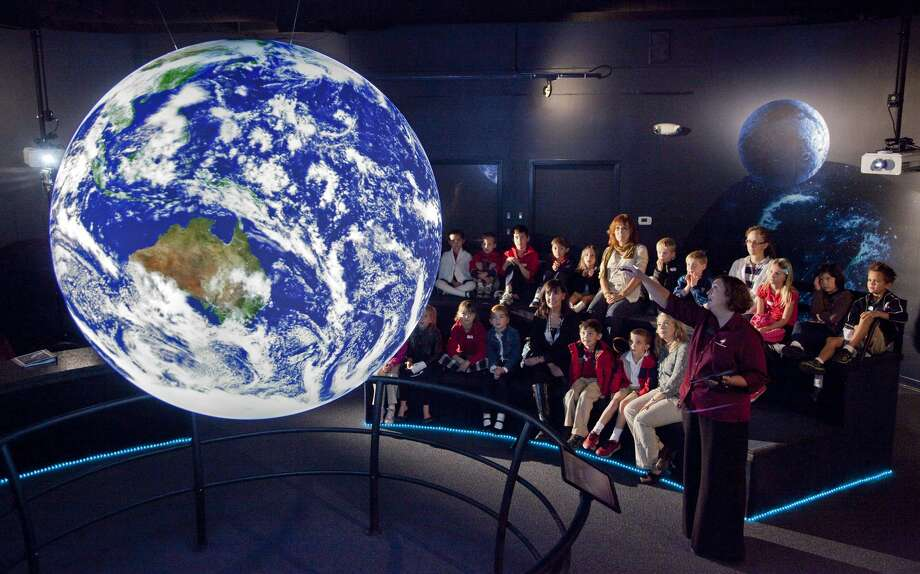 Science on a Sphere (SOAS) is a room-sized interactive system that uses the internet, computers and video projectors to display planetary and astronomical data onto a giant animated globe. Photo: Courtesy Photo