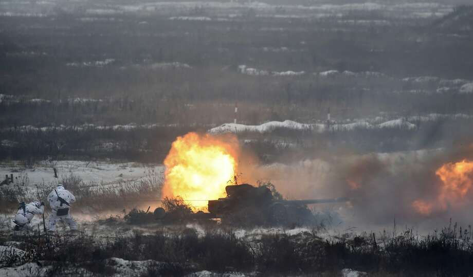 Ukrainian servicemen fire a gun as they take part in brigade tactical exercises with combat shooting near Goncharivske willage, Chernihiv region,  not far from the border with Russia on December 3, 2018 - Tensions between Ukraine and Russia rose on November 25, when Russian forces seized three Ukranian navy vessels and their crew. Ukraine imposed martial law for 30 days in 10 regions that border Russia, the Black Sea and the Azov Sea on November 28. (Photo by Sergei SUPINSKY / AFP)SERGEI SUPINSKY/AFP/Getty Images Photo: SERGEI SUPINSKY, AFP/Getty Images