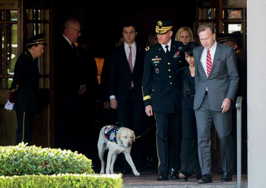 Neil Bush, right, and his wife Maria exit George H. Lewis and Sons Funeral Home during the first departure ceremony for the State Funeral of president George H.W. Bush to Ellington Field Monday, Dec. 3, 2018, in Houston.