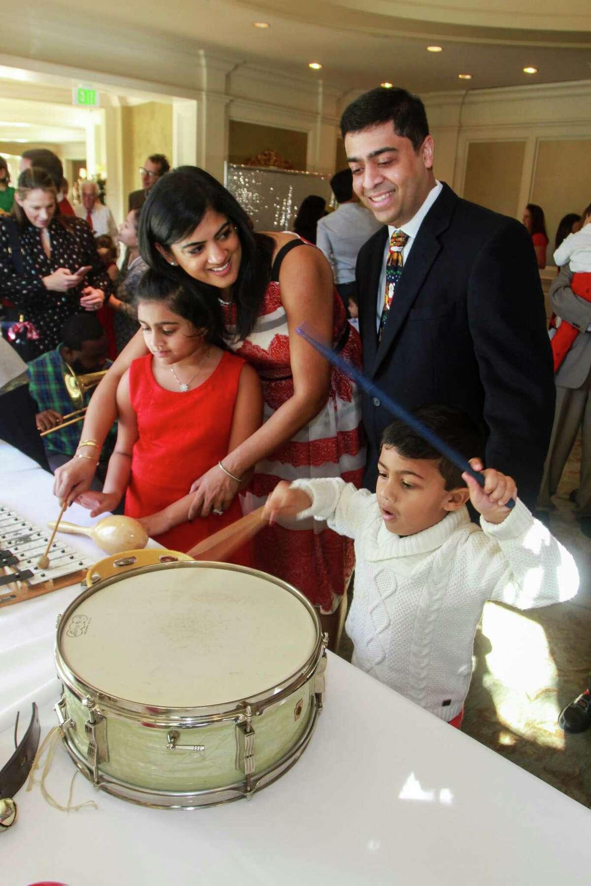 Chairs Ishwaria and Vivek Subbiah, with Sasha, 7, and Nathan, 4, at Houston Symphony's Magical Musical Morning.