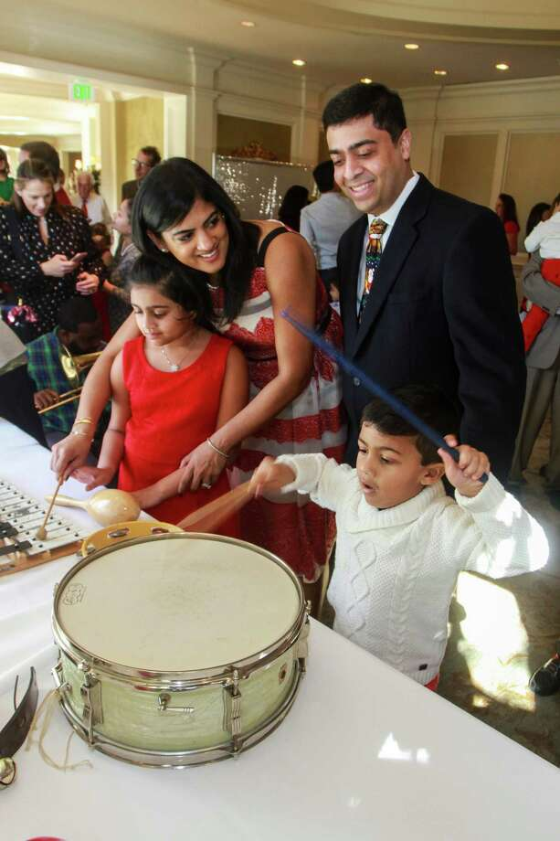 Chairs Ishwaria and Vivek Subbiah, with Sasha, 7, and Nathan, 4, at Houston Symphony's Magical Musical Morning. Photo: Gary Fountain, Contributor / © 2018 Gary Fountain