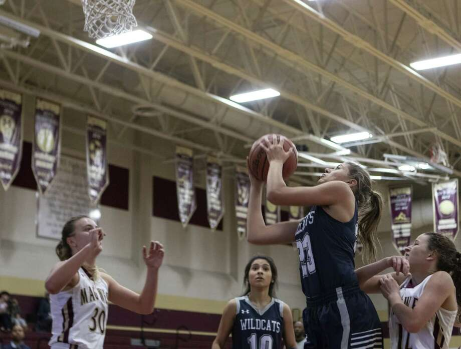 Tomball Memorial sophomore Anna Kate Martinduring (23) shoots during a non-district game Tuesday, Nov. 20, 2018 at Magnolia West High School in Magnolia. Photo: Cody Bahn, Houston Chronicle / Staff Photographer / © 2018 Houston Chronicle