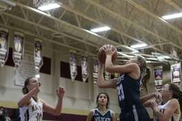 Tomball Memorial sophomore Anna Kate Martinduring (23) shoots during a non-district game Tuesday, Nov. 20, 2018 at Magnolia West High School in Magnolia.