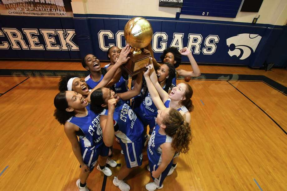 The Cy-Creek girls celebrate their winning of the Cypress District basketball Championship Photo: Tony Gaines/ HCN, Staff / HCN / Houston Chronicle