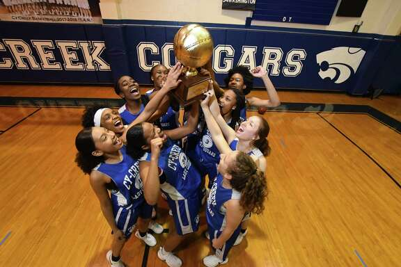 The Cy-Creek girls celebrate their winning of the Cypress District basketball Championship